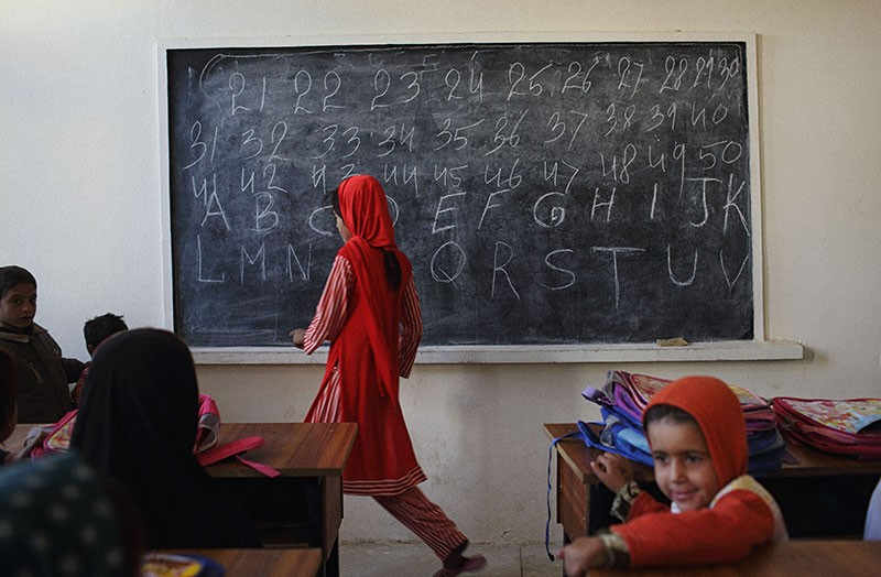 Girls attend class in a classroom at a school in Khost Province, Pakistan.